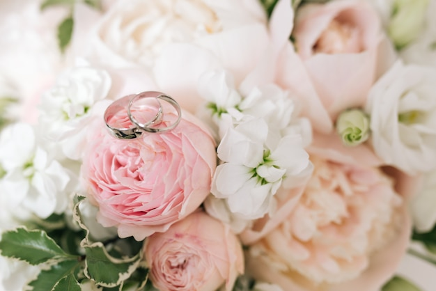 Wedding engagement rings and flowers wedding bouquet background
