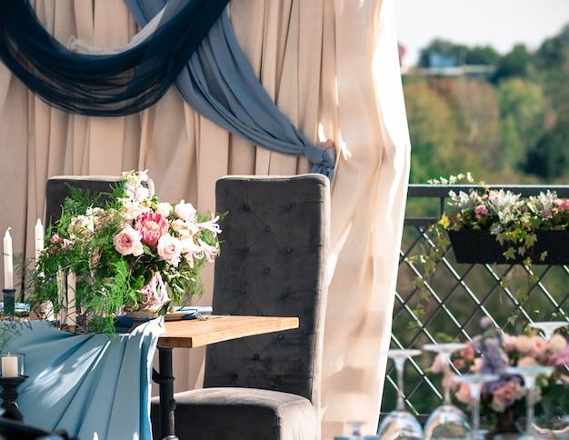 Wedding event decoration setup, sunny summer day, outdoors