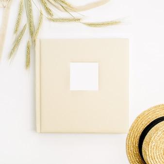 Wedding or family photo album, rye ears, straw