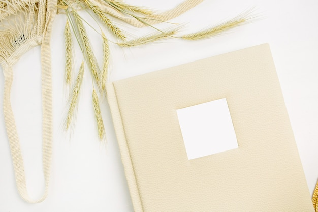 Wedding or family photo album, rye ears on white surface