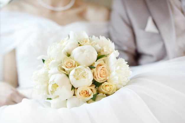 Wedding flowers bouquet with newlywed couple