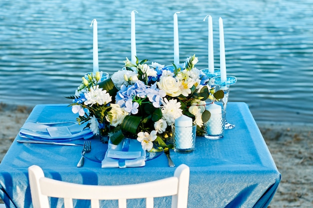 Wedding flowers in summer. exit wedding ceremony by the water.