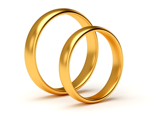 Wedding gold rings lie near each other