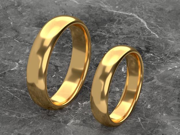 결혼 금 반지가 나란히 놓여 있습니다.