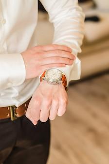 Wedding groom suit, white shirt, brown pants, watch