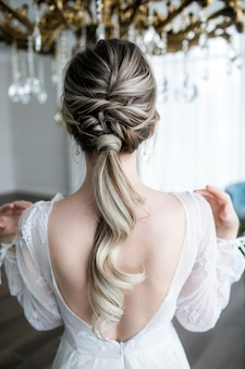 Wedding hairstyle of a beautiful girl close-up