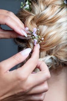 Wedding hairstyle bride flowers stylist hair artist bridal