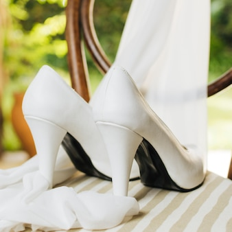Wedding high heels with scarf on table