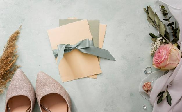 Wedding invitation and bride shoes