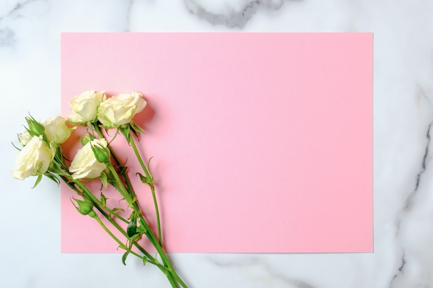 Wedding invitation card. rose flowers and blank pink paper card on marble background. wedding concept.