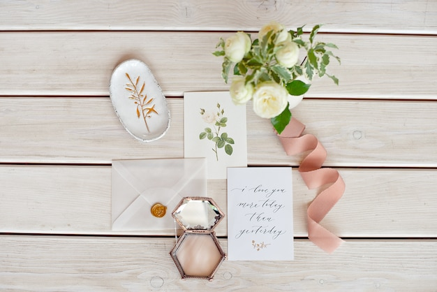 Wedding invitation card with decorations on wood table. rustic wedding overhead view. flat lay, top view wedding invitation card templates.