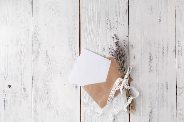 Wedding invitation card with envelope on wooden table