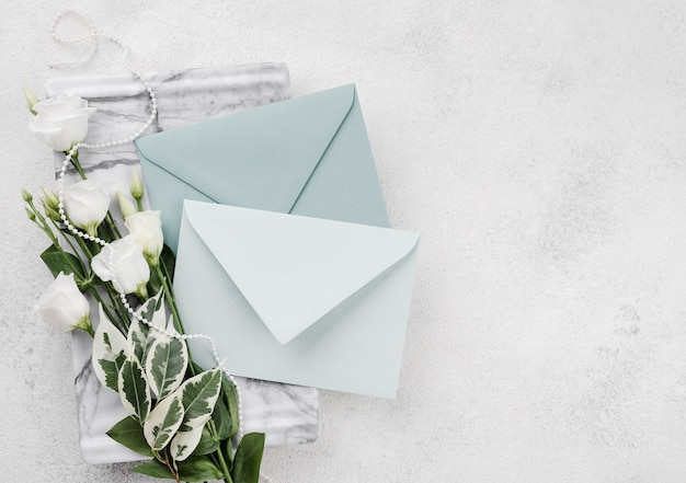 Wedding invitation cards with flowers on the table