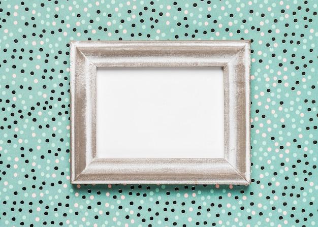 Wedding invitation on patterned teal background