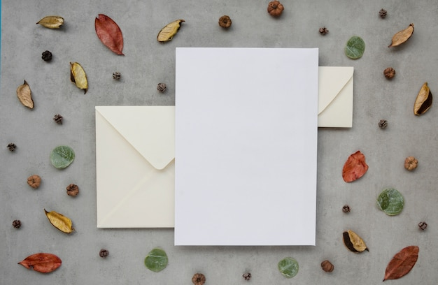 Wedding invitation surrounded by leaves