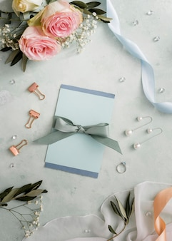Wedding invitations and floral ornaments on table