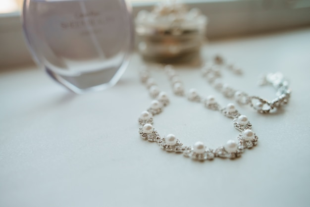 Wedding jewelry and the perfume's bottle. wedding accessories