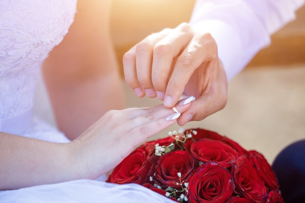 Wedding list of the groom in a suit and the bride in a snowwhite dress closeup the concept of creati...