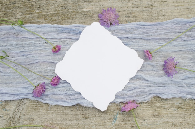 Wedding mockup with pink flowers on a violet runner and olr rustic wood background