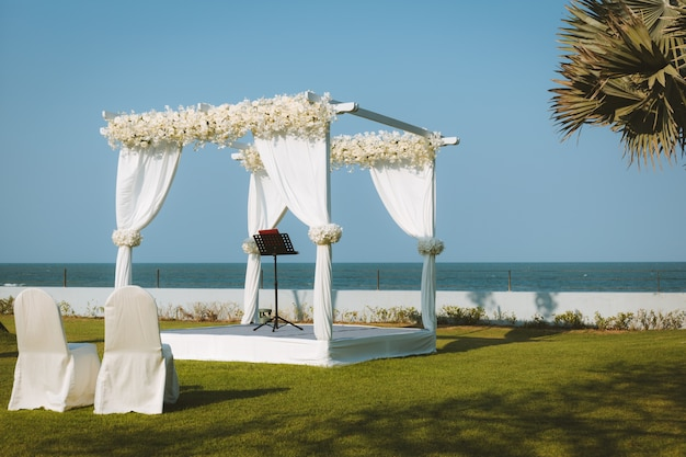 Wedding pavilion set for an outdoor garden wedding by the sea