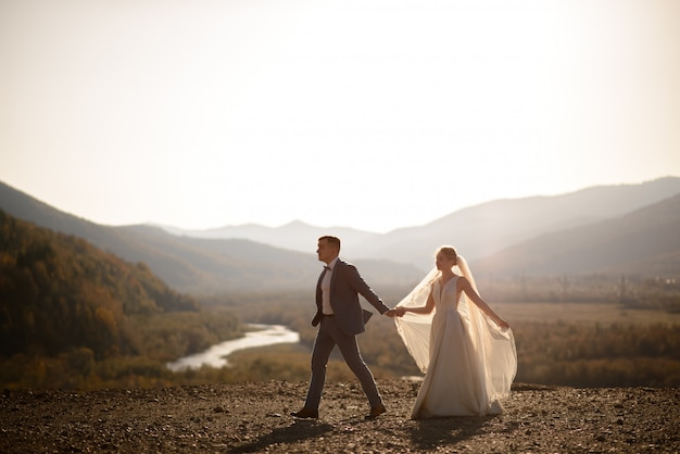 Wedding photo session of the bride and groom in the mountains. photoshoot at sunset.