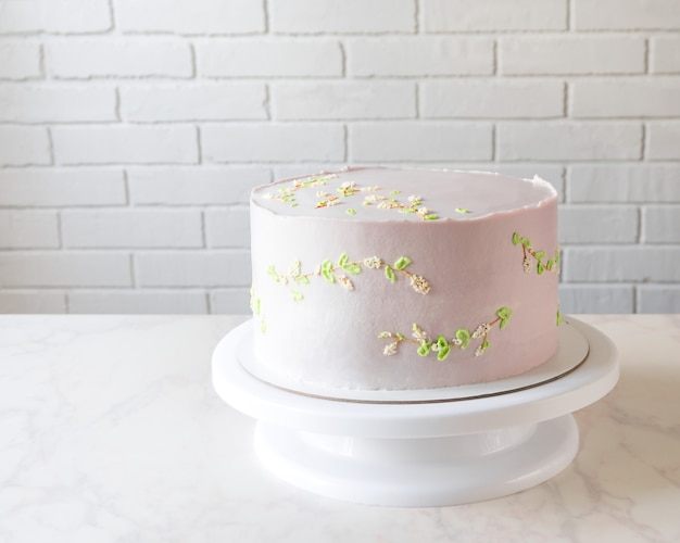 Wedding pink cake on a stand. delicate decor on cake.