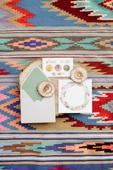 Wedding polygraphy on the carpet in the styles of the boho