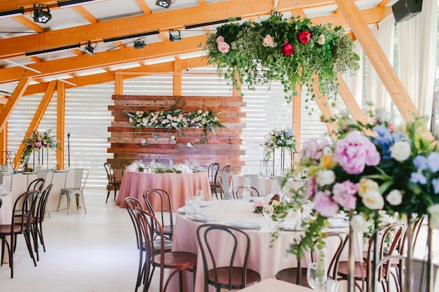Wedding reception decorated with flowers