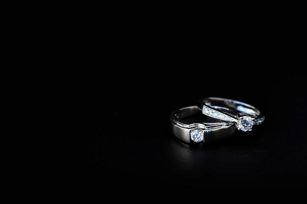 Wedding ring on black table