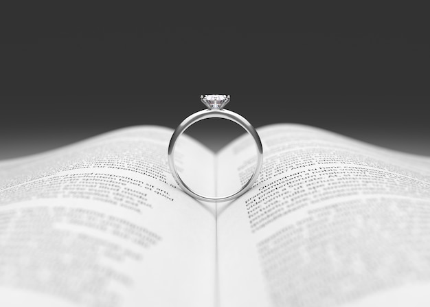 Wedding ring on the book page 3d rendering