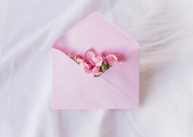 Wedding ring in envelope with flowers