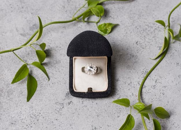 Wedding ring and plants arrangement flat lay