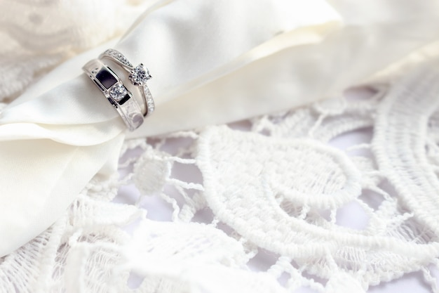 Wedding ring on white table with soft-focus and over light in the background