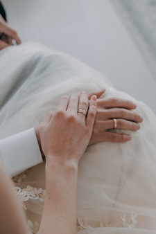 Wedding rings b w. hands of bride and groom with rings.