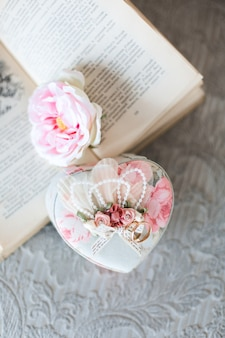 Wedding rings in beautiful decorative casket lying on the  vintage book