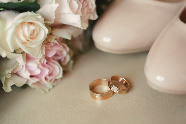 Wedding rings on a bright background
