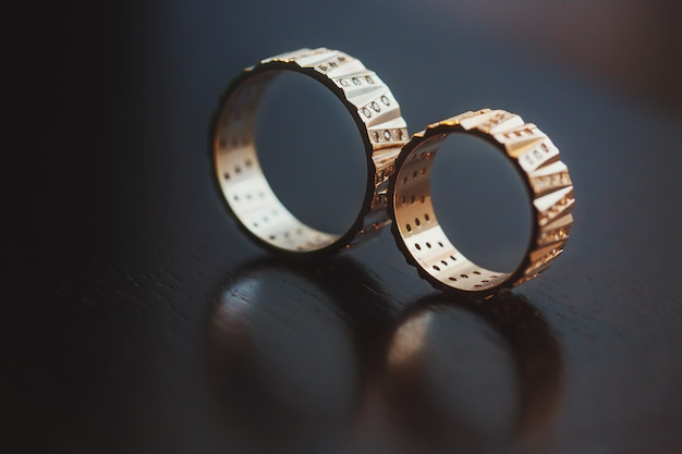 Wedding rings captured with a reflection in a surface