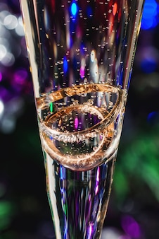 Wedding rings in champagne glass