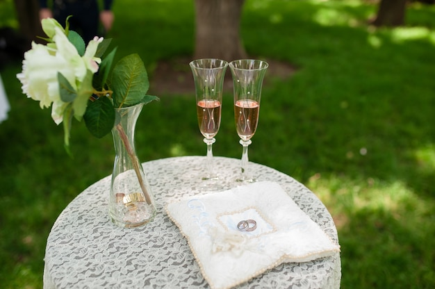 Wedding rings and champagne
