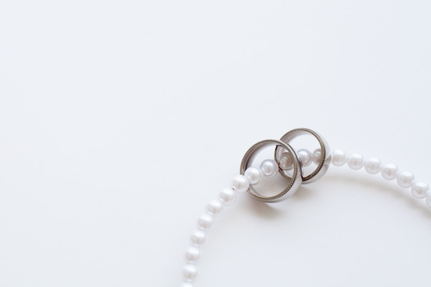Wedding rings close-up in a necklace