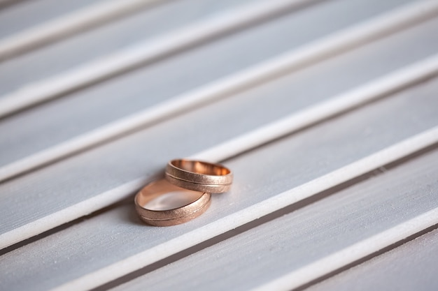Wedding rings close up on wooden table