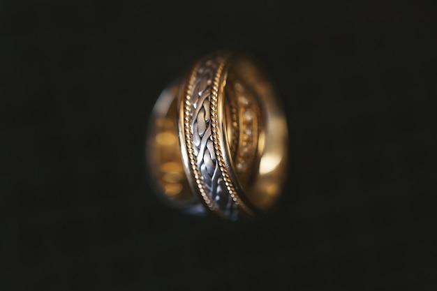 Wedding rings on a dark background