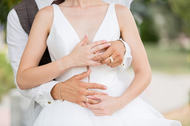 Wedding rings on the fingers of the bride and groom