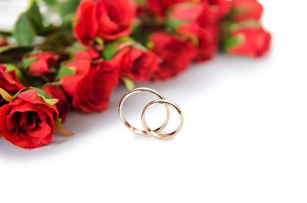 Wedding rings and flowers isolated