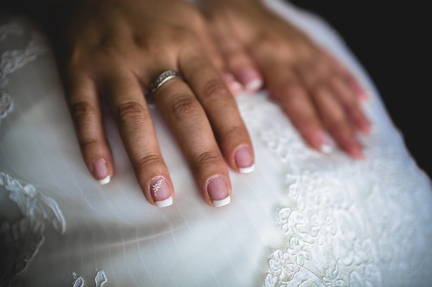 Wedding rings in the hands of a woman in love.