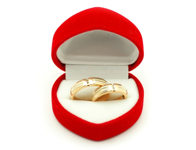 Wedding rings in a heart-shaped red box