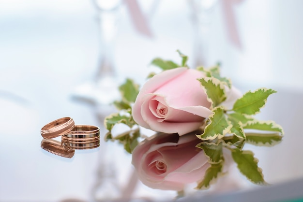 Wedding rings lie next to the buttonhole