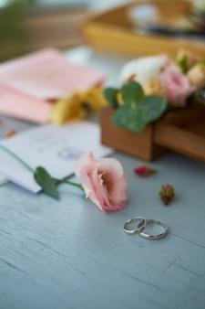 Wedding rings near wedding invitation.