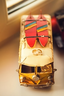 Wedding rings on a toy car