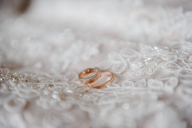 Wedding rings on the wedding dress.